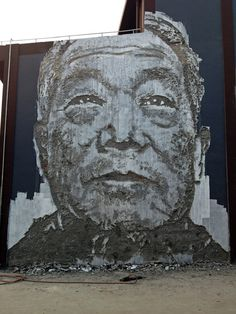 Faces painstakingly scratched into the surfaces of walls in Shanghai, by Vhils(Alexandre Farto) #china #graffitti #streetart #mural #farto