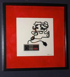 コントローラーのケーブルでゲームキャラクターを描いたアート作品
