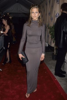 Jennifer Aniston Red Carpet Style: Proving she has the minimalist game on lock, Jennifer Aniston styled a sophisticated and sleek turtleneck with a slim maxi skirt in 1998.