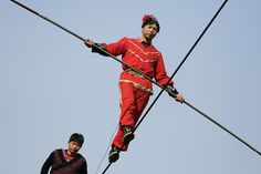 Acrobats perform on a tightrope as the Chinese Lunar New Year, which welcomes the Year of the Monkey, is celebrated at a temple fair, in Beijing, China February 10, 2016.