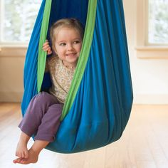 Make the most of an indoor day: hang up a hammock hideaway! It's a perfect cozy place to play or rest.