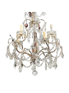 Circa 1920s French chandelier has four candle style lights, a brass cage-form base with clear glass beading, amethyst accents and several large diamond and oval shaped crystal pendants and a large round crystal drop. New wiring for US electrical standards.   TheHighBoy   #highboystyle #antiquesmakeitbetter #antiques #vintage #chandeliers