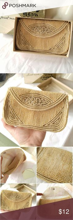 Vtg La Regale beaded clutch faux pearl bridal bag Beautiful vintage evening clutch made of creamy faux pearl beads - Foldover top with snap closure - tag inside says La Regale, comes with vintage box - condition : fair -box has wear and writing and is originally for another bag. Clutch has water stains inside and wear to the back. Despite flaws, is still a beautiful little purse and would be wonderful something old for your wedding :) smoke free home. Vintage Bags Clutches & Wristlets