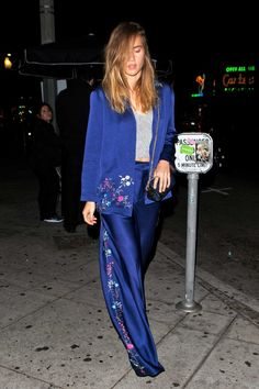 Suki Waterhouse looks effortlessly cool in a silky blue suit with floral details