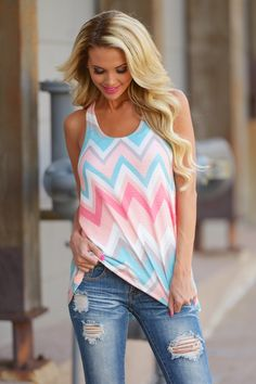 It's time to break out of your shell, push the grey and black to the back of your closet, and embrace all the beautiful colors of summer! Distressed racer back tank in a pretty peach and mint chevron print. from Closet Candy Boutique