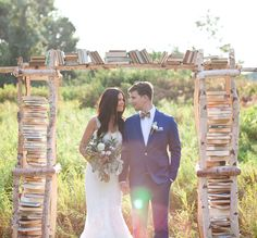 Book Lovers Delight! Birchwood Ceremony Backdrop Filled With Books!   Vintage Fall Wedding Inspiration