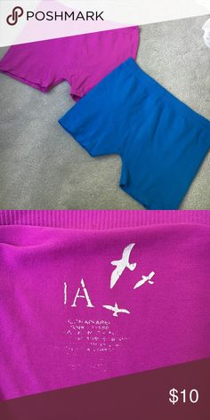 Two pairs of spandex Price includes both pairs of spandex/compression shorts: purple and blue. So stretchy they'll fit anyone! They're seamless on the sides and only worn a handful of times. The washing machine peeled off the labeling as shown in the picture but everything else about them looks brand new! Perfect for getting in shape for that summer bod ;) Shorts