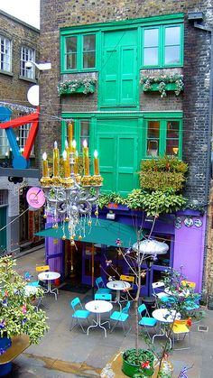 Neal's Yard ~ a small alley in Covent Garden between Shorts Gardens and Monmouth Street which opens into a courtyard. It is named after the 17th century developer, Thomas Neale. It now contains several health food cafes and New Age retailers such as Neal's Yard Remedies, Neal's Yard Dairy, and World Food Cafe.