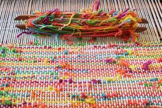 Weaving with cotton scrap yarn in bright colors;by perpetual amateur.