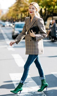 This ensemble feels very right now with the plaid blazer and statement sock boots paired with rolled-up skinnies.
