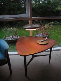 Superb quality Danish Coffee Table, unattributed design together   with a Fase Lamp produced in Madrid, 1960's.