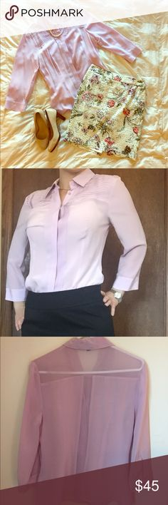 Light purple Bebe silk blouse Light purple button up silk blouse. Hangs great tucked in or long depending on why you choose to pair it with. Light and sheer. Modeled is shown without an under tank but it is more see through in bright lights. Great dress up for work on conferences. Excellent condition. 100% mulberry silk bebe Tops Blouses