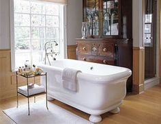 In this master bathroom, designed by Paolo Moschino, a 19th-century English secretary makes a surprising focal point.