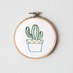 Add some texture to your wall decor with this adorable embroidery hoop art.
