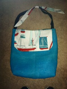 Fun blue burlap tote bag with seascape fabric. Fully lined and finished. Also features a key fob and a velcro closure flap. Triple stitched for durability.
