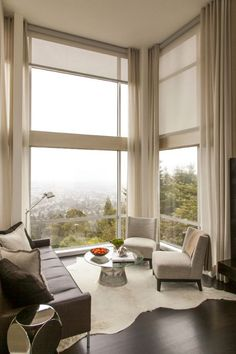 Bright sunlight is a not a problem for these floor to ceiling living room windows in the Berkeley hills with custom motorized window shades that cut glare and heat.