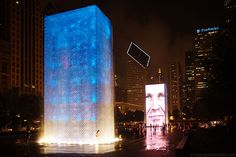 The Crown fountain is a modern fountain, unveiled in 2004 in Chicago's Millennium Park. The fountain consists of two glass towers illuminated by LED displays that show faces of Chicagoans.