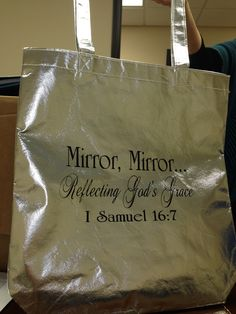 Another view of silver, retreat themed reflective bags ordered for all the women who attended retreat to hold all of their materials.