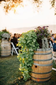 greenery wedding decor with wine barrels / http://www.himisspuff.com/rustic-country-wine-barrel-wedding-ideas/10/