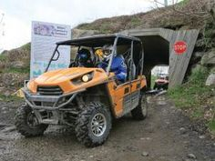 location.hatfield-mccoy.side-x-sides-and-atvs.riding.through-tunnel.
