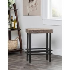 This contemporary eco-friendly counter stool adds a unique look to your space. Add some style and charm to any space with the Kosas Home Rover Reclaimed Pine and Iron Counter Stool.