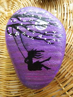 """Girl on the swing"" hand painted rock. Acrylic paint and glossy clear coat. #paintedrocks #rockart #BuckleyRocksToo"