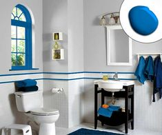 A neutral bath gets a shot of color with a bright blue window casing and defining trim work. | Jay Blue SW 6797, @SherwinWilliams