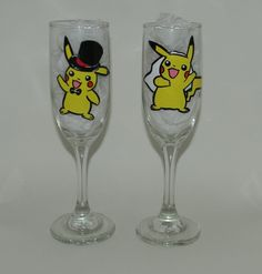 Pikachu bride and groom champagne flutes set of 2. Hand painted champagne flutes set of 2 with a Pikachu bride and groom on them. Each one of my glasses is hand painted, no stickers or vinyl are used, and they are hand wash only. Because of the nature of each glass being hand painted, lines may vary from glass to glass, and color may vary from different screen resolutions. Please don't hesitate to contact me with any questions you may have! **Champagne flutes style may vary slightly from...