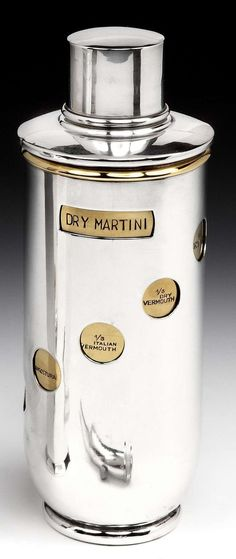 "An unusual Art Deco cocktail shaker in the style of the iconic Asprey ""Tells-U-How"" w/ a silver-plated sleeve which can be rotated to display the gilded inner body w/ stamped recipes including ""Brandy"", ""Pernod"", ""Between"", ""Dry Martini"", and ""Palm Beach"" [sic]. (hva)"