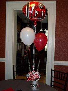 Balloon centerpiece with galvanized tin pail base for reception before the University of Georgia football game