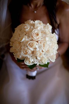All white bridal bouquet. // Photo by: http://joannatano.com