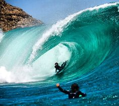 Bodyboarding and catching a barrel of a 6-10 feet wave.