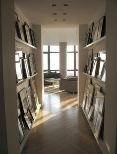 Photo shelves would work very well in the hallway in my home...I love moving photos around - this is perfecto!
