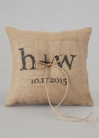 "Burlap is a beautifully rustic fabric to add to your wedding day. Personalize this Burlap Ring Bearer Pillow with your initials and wedding date. Finished with a jute cord tied in a bow, this pillow will be the right piece for your rustic wedding.  Features and Facts:   Size: 8"" square  Made of burlap  Initials are lowercase. The ""+"" in between the initials is standard. Wedding Date includes up to 15 characters including spaces and special characters."