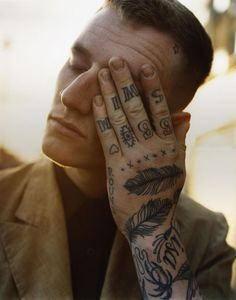 Hand. Tattoos, body art.