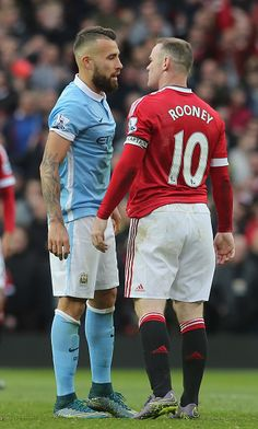 Wayne Rooney of Manchester United clashes with Nicolas Otamendi of Manchester City during the Barclays Premier League match between Manchester United...