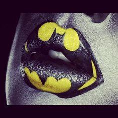 Cute(: yellow lipstick base, use black eyeliner to outline batman sign, than black lipstick.