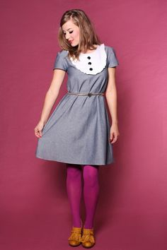 Love the dress but love even more the mustard shoes and purple tights combo.