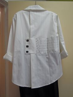 Siga Bari - unusual detailing on back of button down white shirt.
