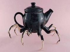 Teapot with legs.