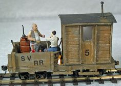 THE WORKBOOSE by BOULDER VALLEY MODELS. The extra details, tools, drums, jacks, the two men (Artista figures)
