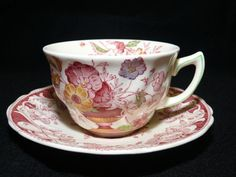 One of my favorite patterns is Pomeroy by Royal Doulton. This set is a vintage red transferware cup and saucer dating to about the 1930's. The border is a mix of fruits and flowers intertwined with sc