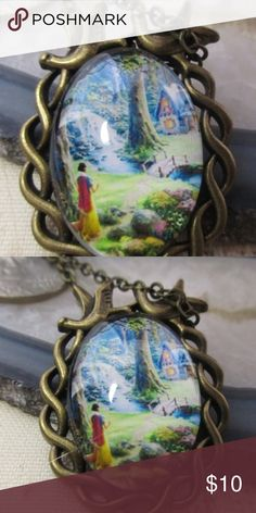 Snow white pendant necklace Dwarf's cottage Snow white walking through the forest, seeing the 7 dwarf's cottage for the first time! Her wonder and surprise at the perfect little cottage in the woods. Pendant has a 20 inch bronze color chain, and a the frame is bronze entwined and topped by two birds, just like in the movie. Jewelry Necklaces