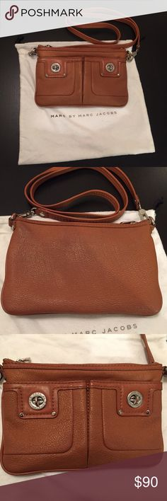 "Marc by Marc Jacobs ""Totally Turnlock Percy"" Bag Marc by Marc Jacobs ""Totally Turnlock Percy"" Bag. Color: tan. Worn many times but still in good condition. See pictures for faults. Leather cross-body bag fraud idea logo turn-lock closures at the patch front pockets. Silver hardware. Detachable shoulder strap and zip main compartment closure. Logo-lined inferior features patch pocket. 6.5"" H x 9.5"" L. 24"" strap drop. Comes with original dust bag! Marc by Marc Jacobs Bags Crossbody Bags"