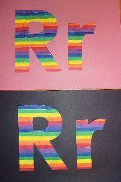 De letter r van regenboog. Kan met stroken papier plakken maar ook met waterverf strepen!