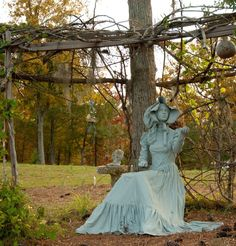 Garden Sculpture I created. Mannequin, dress & gown soaked in Jiffy fabric stiffener, then styled as it dried and painted with some masonary sealer. She is even water proof.