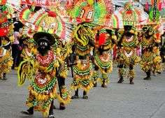 """Ati-Atihan Festival.  Starts from the16th to the 22nd of January in Kalibo, Aklan. Revelers masquerading as Negritos in colorful costumes, dance to the beat of drums while chanting """"Hala Bira!"""" in preparation to the Sunday procession in honor of the Santo Niño."""