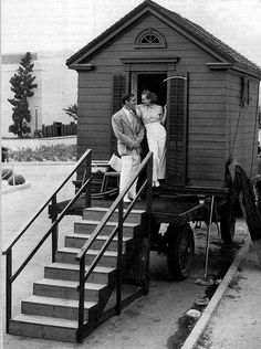 Clark Gable and Joan Crawford in front of her portable bungalow. -  To connect with us, and our community of people from Australia and around the world, learning how to live large in small places, visit us at www.Facebook.com/TinyHousesAustralia or at www.TinyHousesAustralia.com