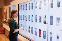 Virgin in-store. The giant POS touch screen walls have already proven successful at increasing sales.
