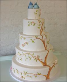 Lovely nature theme decorated wedding cake—topped with adorable little love birds❣ Wedding20 - ninecakes.com